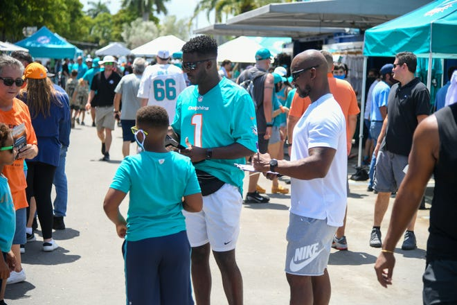Fan enjoy their first day as spectators at Miami Dolphins training camp, July 31, 2021.