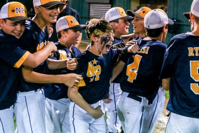 North Providence players celebrate after winning the Rhode Island Little League championship on July 30.