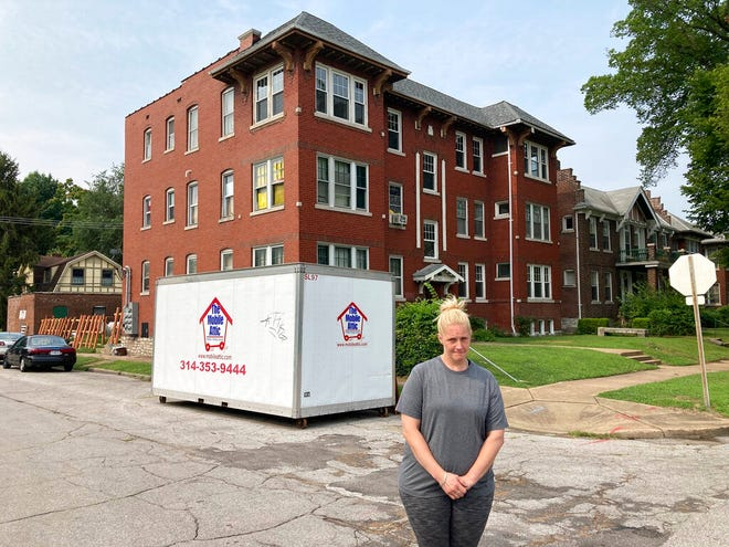 Kristen Bigogno stands in front of her St. Louis apartment on July 30, 2021. A storage trailer sits behind her. Bigogno expects to be evicted, along with her two teenage sons, soon after the federal moratorium ends after Saturday. She says they have no place to go and may face homelessness. AP Photo by Jim Salter