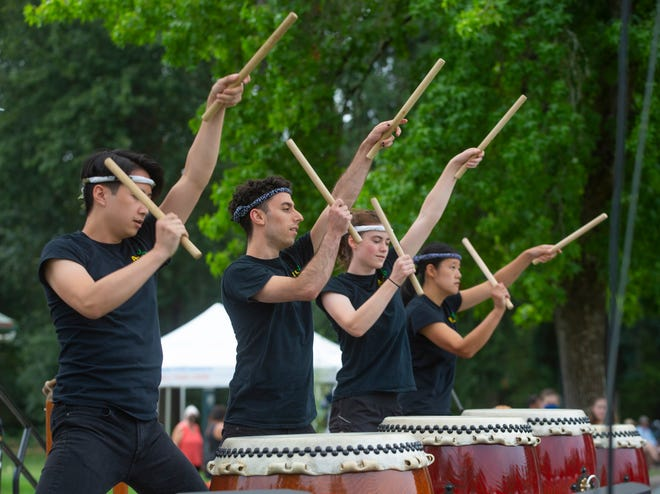 Members of the taiko ensemble Ahiru Daiko from the University of Oregon perform on the drums during the Oregon Asian Celebration at Alton Baker Park in Eugene.