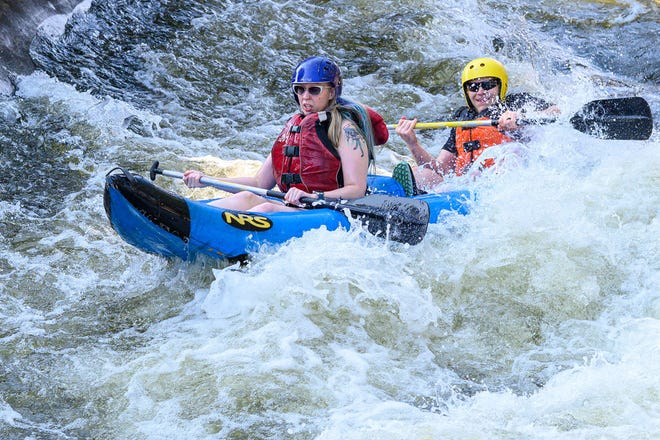 Laura and Ryan Nichols paddle down South Bend's East Race Waterway for the Urban Adventure Games on July 31.