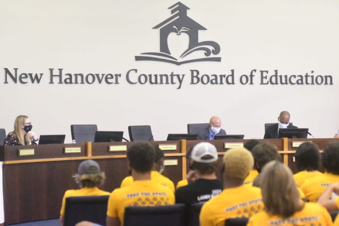 A large crowd gathered at the July 13 board meeting that quickly turned to chaos. The August school board meeting will be virtual because a board member tested positive for COVID-19.