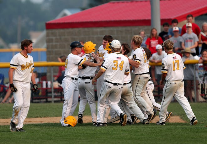 Redfield Post 92 celebrates their 5-4 win in Friday's opening round against Vermillion Post 1 in the Class B Legion State Tournament in Groton. Keaton Rohlfs had the game-winning hit in the bottom of the seventh. American News photo by Jenna Ortiz, taken 07/30/2021.