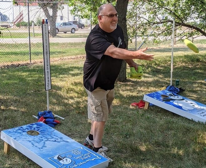 Tim Rogers of Mina lets a bag fly while practicing before the cornhole tournament at Saturday's Bands, Brews and BBQs event at Centennial Village at the Brown County Fairgrounds. The annual gathering is a fundraiser for the South Dakota Snow Queen Festival.