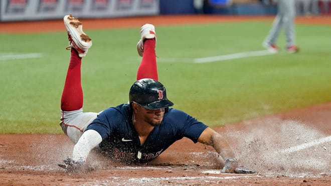 Boston Red Sox's Xander Bogaerts scores on an RBI single during the Red Sox's 7-3 loss Friday in St. Petersburg, Fla.