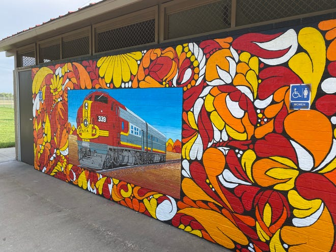 The Santa Fe Park public art project was created by Jamie Colon, Andy Valdivia and Robert Tapley Bustamante. One panel features a Santa Fe train.