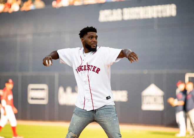 Boxer Kendrick Ball throws out the first pitch ahead of the WooSox game against Buffalo last Friday.