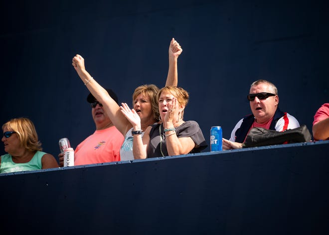 Fans cheer on the WooSox against Buffalo July 31 in Worcester.