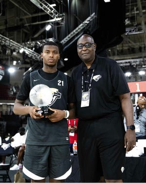 Five-star 2022 point guard and UNC basketball recruiting target Jaden Bradley (left) was named MVP at the NBA Players' Association Top 100 Camp last Friday. Bradley led the event in points and assists per game and helped his team win the showcase's Friday championship.