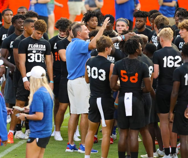 Florida Gators head coach Dan Mullen talks with player during Friday Night Lights, the annual high school football showcase hosted by the Florida Gators, held on Florida Field at Ben Hill Griffin Stadium on the University of Florida campus, in Gainesville, Fla., July 30 2021.