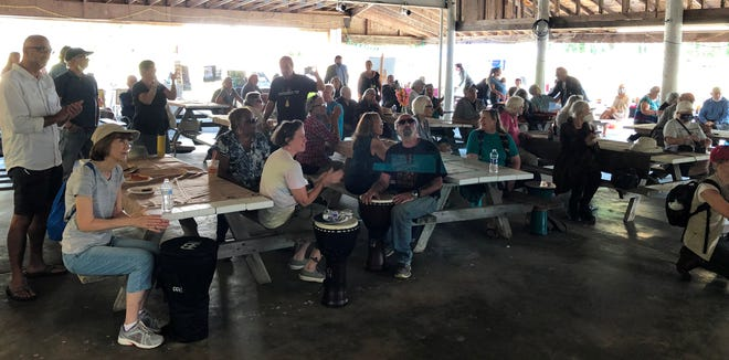 About 100 people attended a rally Saturday at the Onset VFW, one of two held in the state, to enlist support to impose a state moratorium on subsidizing solar projects that clear cut forests in the interest of green energy. The other rally was held in Greenfield.