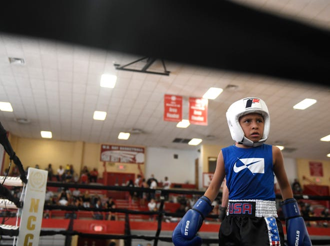 Robert Rosenbaum pauses before his Games of Texas boxing match, Saturday, July 31, 2021, at Ray High School. Athletes from around the state competed in the meet.