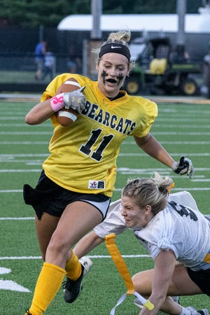 Abbi Stanforth attempts to rush through the defense in the first Paint Valley girls football game to help boost local spirit for fall sports in Bainbridge, Ohio, on July 31, 2021.