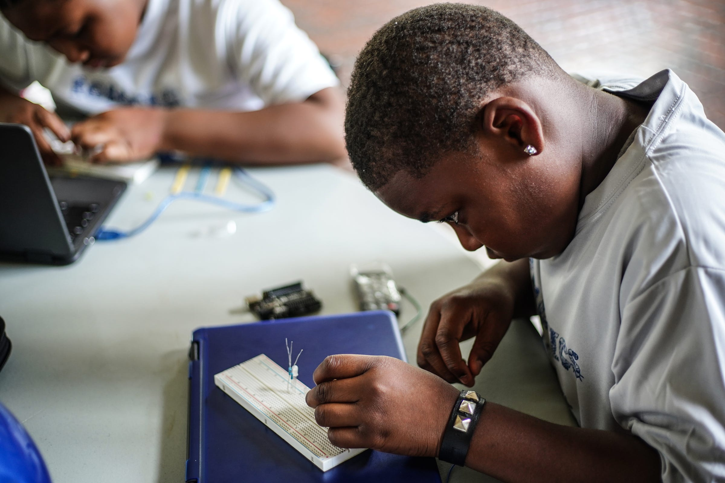 Dion Reaves, 8, of Detroit works on robotics project at Marygrove College in Detroit on July 29, 2021. Detroit City Lions, a youth program founded by Devon Buskin is more than a youth football program. The program offers robotics classes, volleyball, musical arts along with football and cheer.
