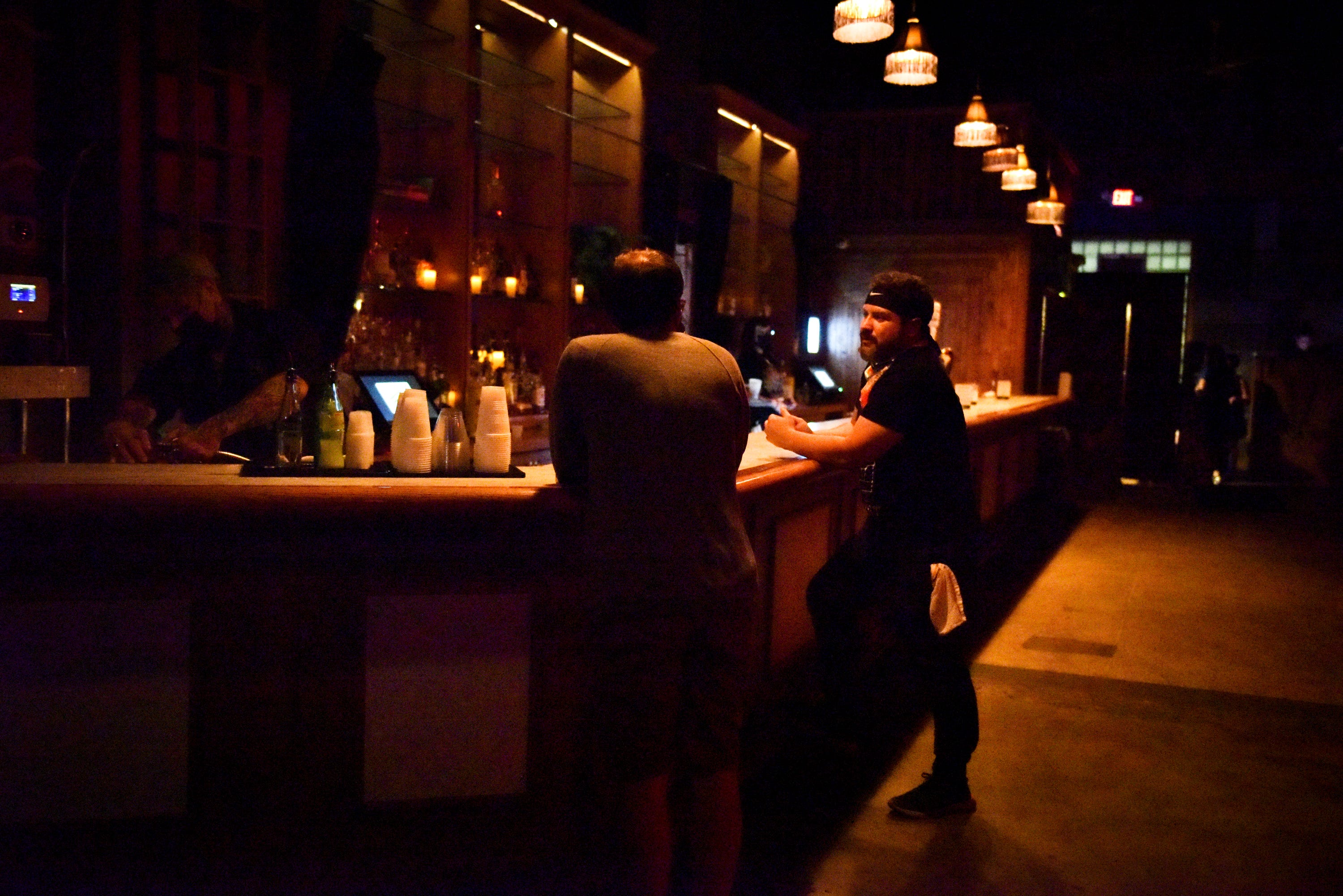 The Marble Bar in Detroit is slow to fill with customers on July 30, 2021, the first night it required patrons to show proof of vaccination or negative COVID-19 test results in order to be admitted into the venue. The emergence and spread of the Delta Variant was cited as the reason for the additional safety measures.