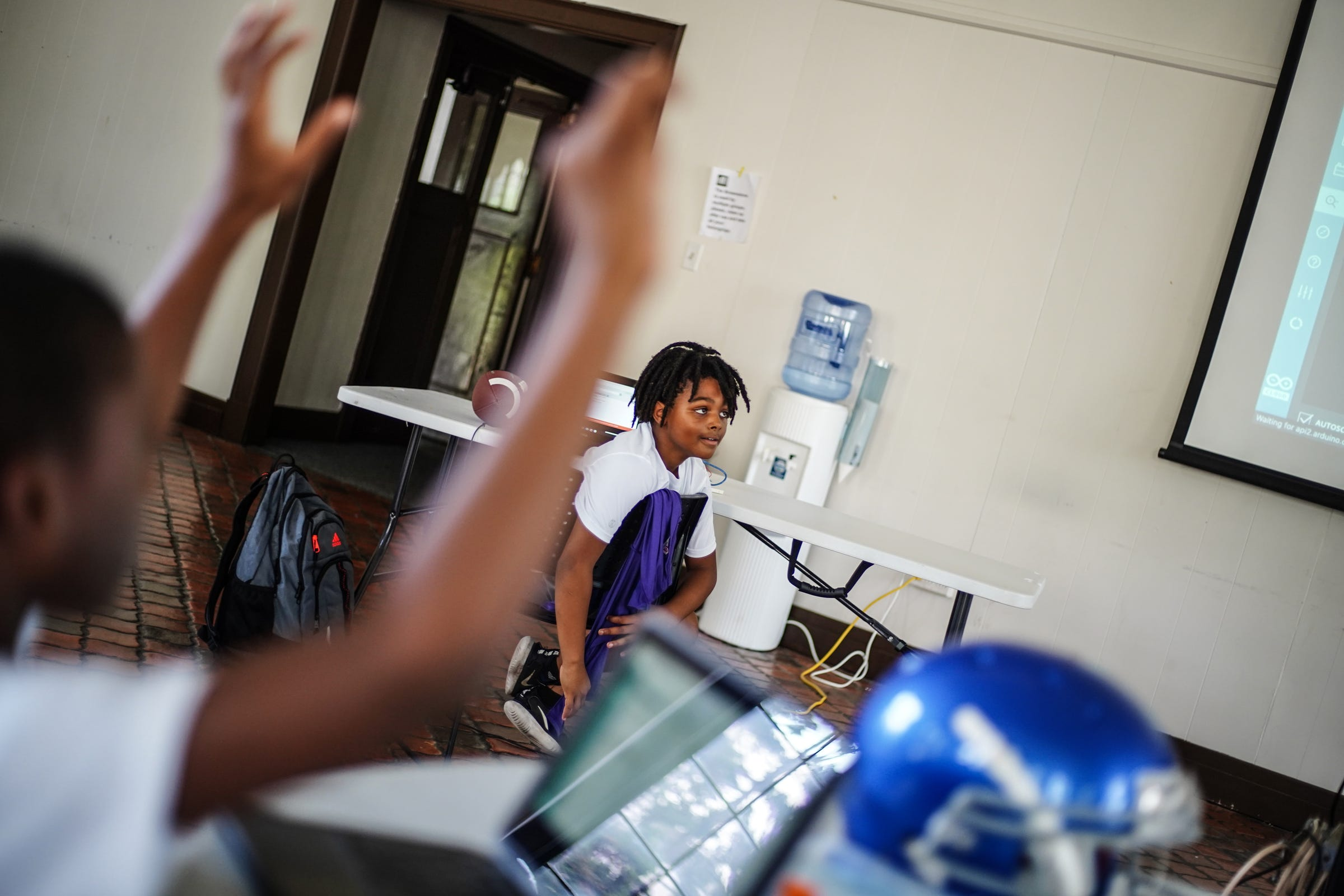 Detroit City Lions players in robotics class at Marygrove College in Detroit on July 29, 2021. Detroit City Lions, a youth program founded by Devon Buskin is more than a youth football program. The program offers robotics classes, volleyball, musical arts along with football and cheer.