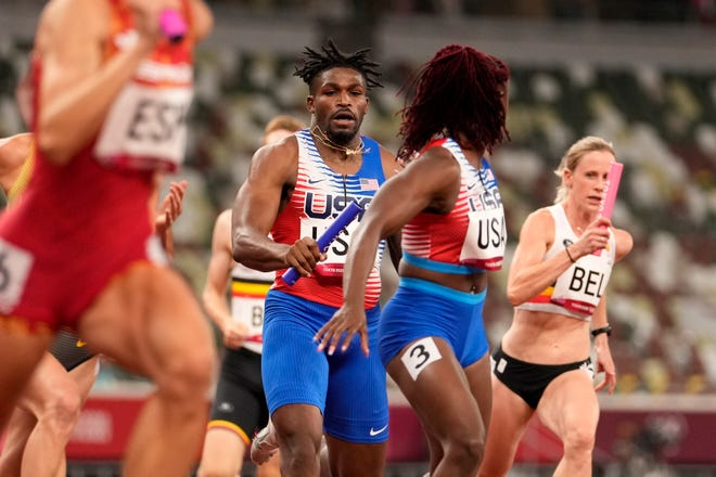 Elija Godwin hands over the baton to Lynna Irby during the 4 x 400-meter mixed relay at the 2020 Summer Olympics, Friday, July 30, 2021, in Tokyo, Japan. (AP Photo/Martin Meissner) The U.S. team was disqualified Friday because Irby was out of place when she took the handoff. But that was deemed the fault of officials and Irby and Team USA earned a bronze in the relay on Saturday.
