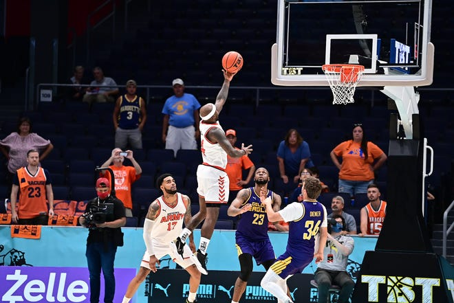 Tyrese Rice scores the winning bucket for Boeheim's Army against the Golden Eagles in The Basketball Tournament on Saturday.