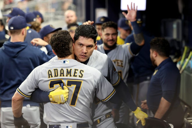 Brewers outfielder Avisail Garcia celebrates his three-run home run with shortstop Willy Adames during the third inning Friday night in Atlanta.