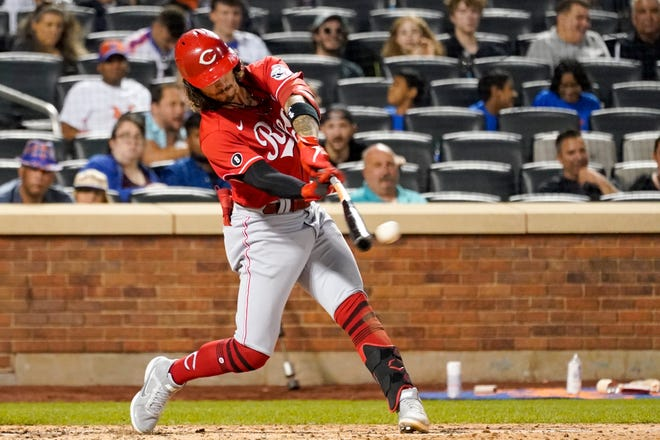 Cincinnati Reds' Jonathan India hits a double the fifth inning of the baseball game against the New York Mets, Friday, July 30, 2021, in New York. (AP Photo/Mary Altaffer)