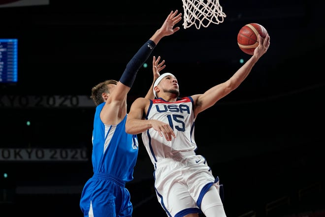 United States's Devin Booker (15) drives to the basket against Czech Republic's Jan Vesely (24) during a men's basketball preliminary round game at the 2020 Summer Olympics, Saturday, July 31, 2021, in Saitama, Japan. (AP Photo/Eric Gay).