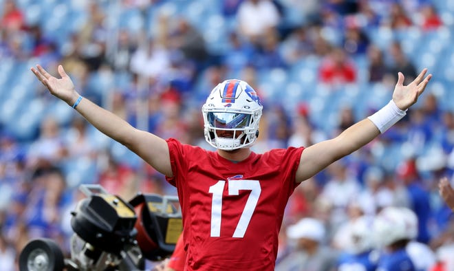 Quarterback Josh Allen jokingly makes fun of an assistant who dropped a perfect pass by teammate Jake Fromm during a training camp practice.