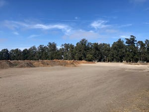 The future aquatic center and parking spaces will fill the empty field owned by the city, north of Oxnard College.