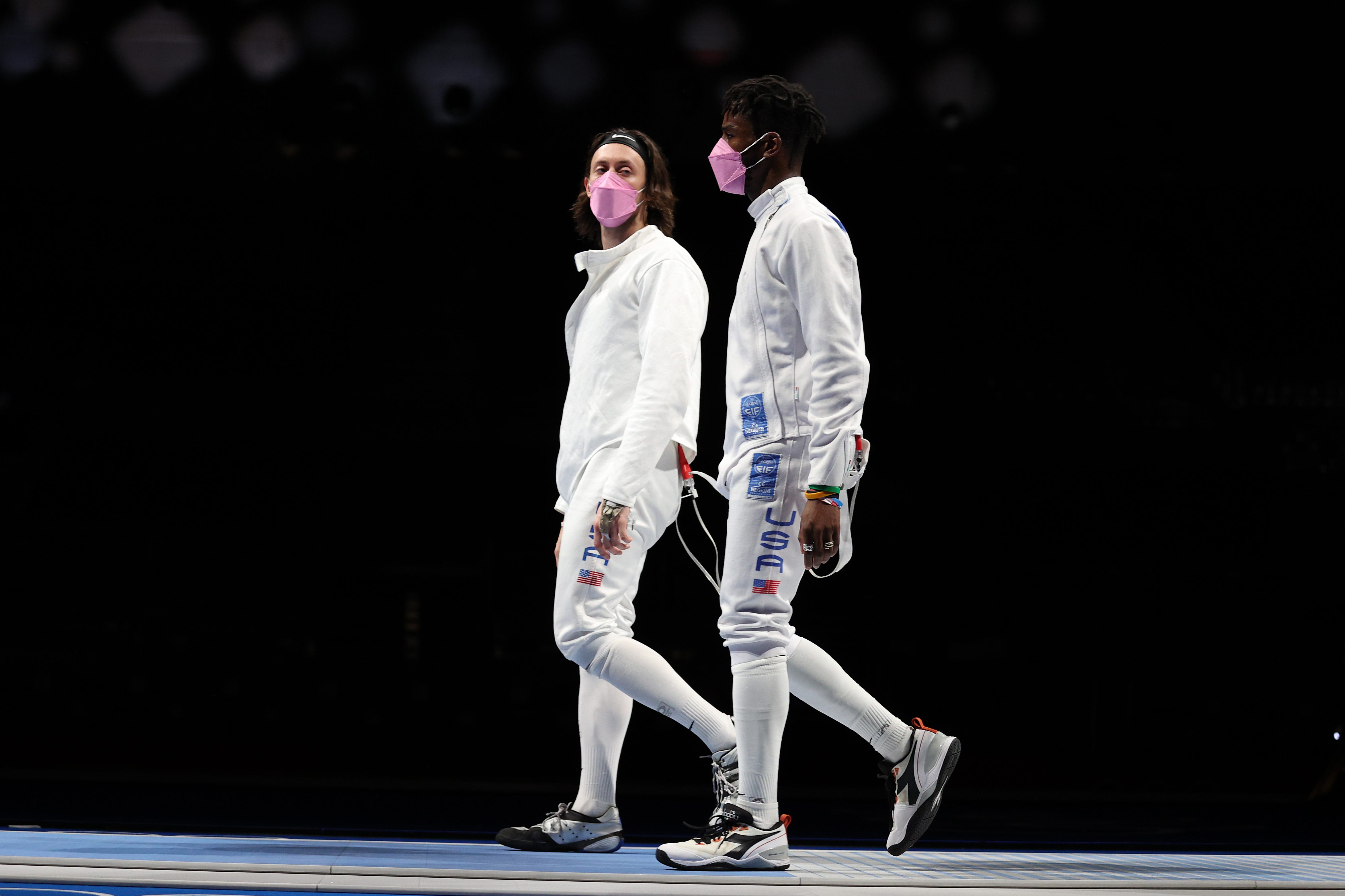 US fencer Alen Hadzic confronts teammates wearing pink masks in apparent protest of his inclusion on team