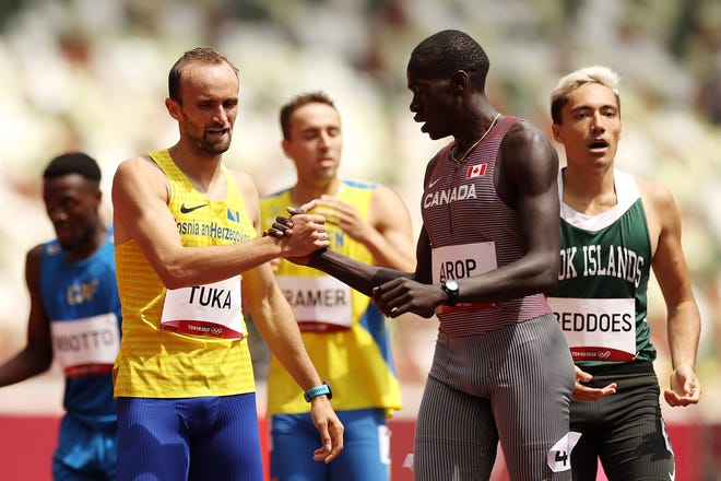 Amel Tuka of Bosnia and Herzegovina and Marco Arop of Canada congratulate each other after competing in the 800 at the Tokyo 2020 Olympic Games.