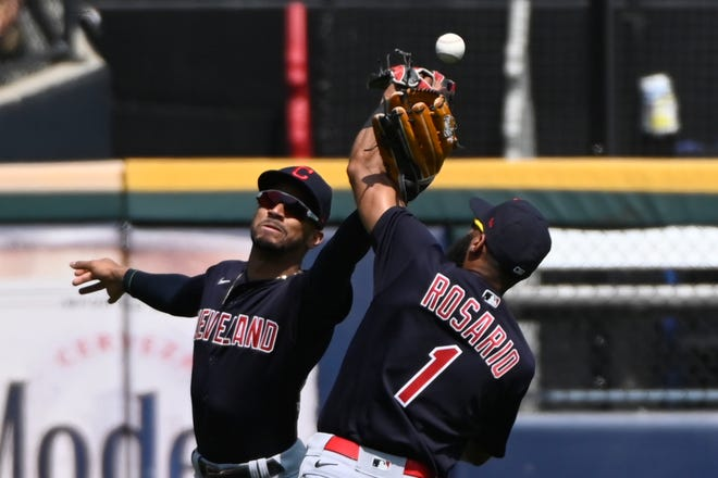 Cleveland center fielder Oscar Mercado, left, and shortstop Amed Rosario (1) try and make a play on a ball hit by Chicago White Sox's Brian Goodwin during the fifth inning of a baseball game, Sunday, Aug. 1, 2021, in Chicago. (AP Photo/Matt Marton)