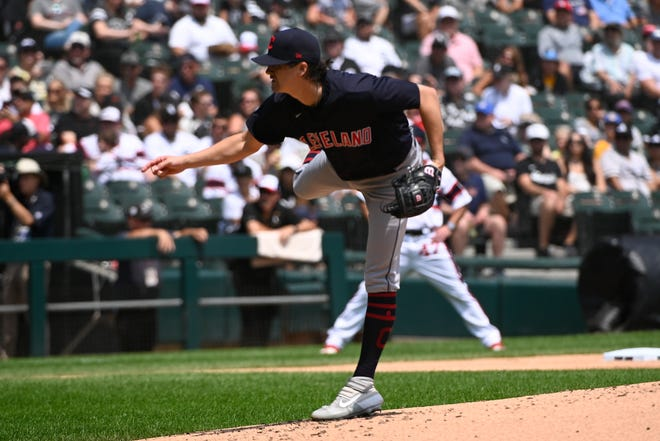 Cleveland starting pitcher Cal Quantrill delivers during the first inning of a baseball game against the Chicago White Sox, Sunday, Aug. 1, 2021, in Chicago. (AP Photo/Matt Marton)