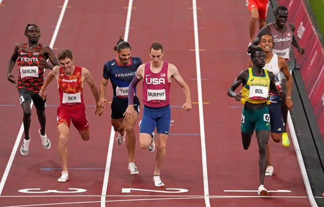 The USA's Clayton Murphy, a former University of Akron standout, finishes second to Peter Bol, of Australia, right, in a semifinal of the men's 800-meter at the 2020 Summer Olympics, Sunday, Aug. 1, 2021, in Tokyo, Japan. [Charlie Riedel/Associated Press]