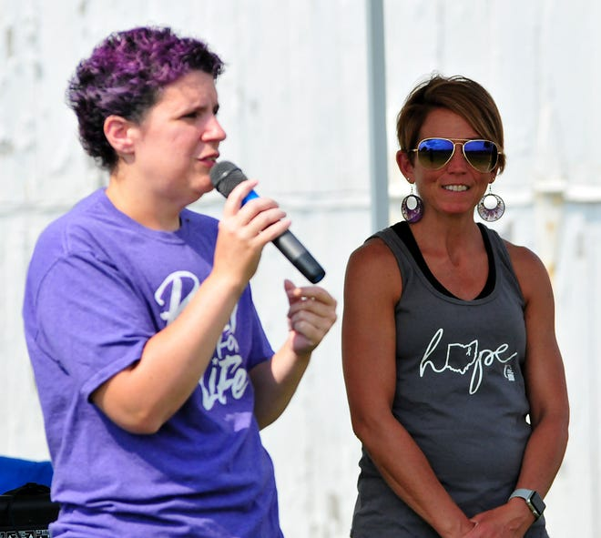 Cancer survivor Sylvia Sanderson (left) talks about her survival story with event co-chair Sunshine Imhoff at her side during the opening ceremony for Relay For Life at the Ashland County Fairgrounds Saturday.