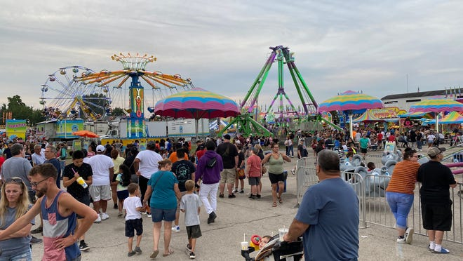 The packed midway at the Lenawee County Fair is pictured Friday evening. Fair organizers are expecting to find large numbers of people came to the fair this year when final totals are tabulated.