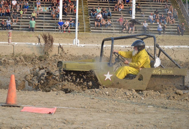 A driver makes his way through the mud pit during the Ottawa County Fair Mud Runs on Saturday, July 31, 2021.