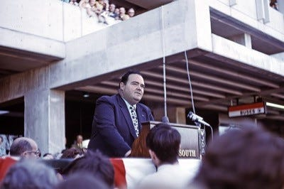 Quincy Mayor James R. McIntyre greets an excited crowd at South Shore Red Line opening day ceremonies at Quincy Center Station on Sept. 1, 1971.