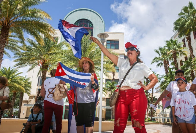 People take part in a rally at West Palm Beach city hall to support anti-government protesters in Cuba, Sunday, July 18, 2021.