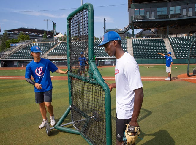 Eugene Challengers pitchers Isaac Eveniew, left, and Cho Tofte set up for batting practice at PK Park before the team headed to Gillette, Wyoming, for the American Legion Northwest Regional tournament.