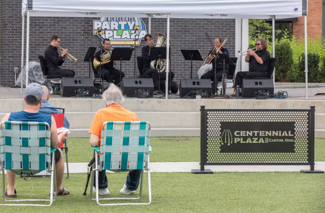 The Canton Symphony Orchestra Brass members Justin Rowan, left, Ben Reidhead, John Caughman, Sean McGhee, and Sean Monigold perform Sunday during the inaugural Party in the Plaza in Canton. (Bob Rossiter / Repository)