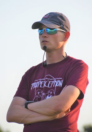 """New Owen Valley Band Director, Dylan Cramer, watches and listens from above, as this year's Marching Band practices their season performance, """"Into the Clouds."""""""