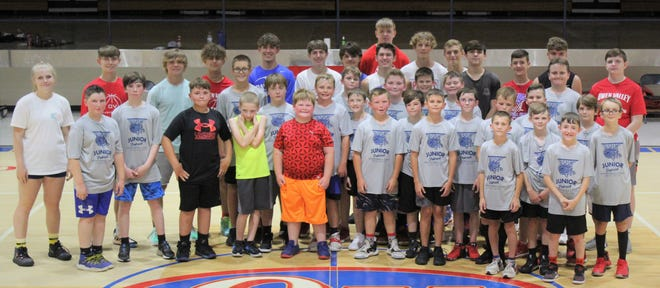 The Junior Patriot Basketball League had 31 boys register for their recent camp held at OVHS. They are shown with current OVHS boys' basketball team members who helped out during the week.