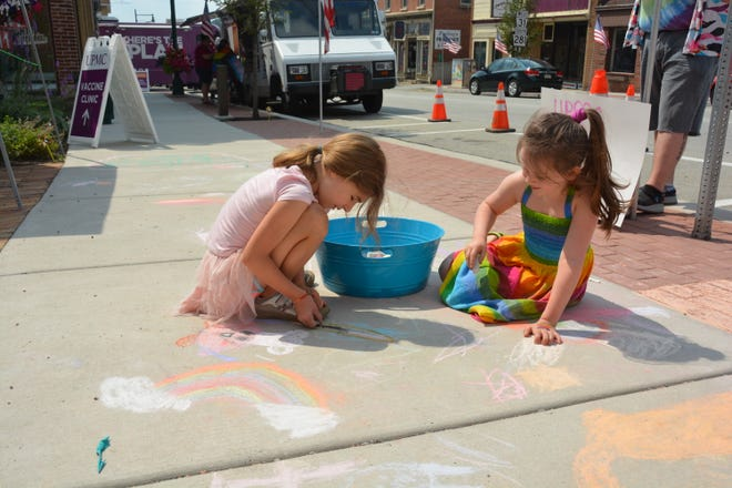 Mia Bailey (left) and Rella Wilt, both of Salisbury, color with chalk on the sidewalk, during the Somerset Pride Picnic on Sunday at Trinity Park (Alexis Park) along West Main Street.