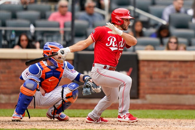 Cincinnati Reds' Max Schrock hits an RBI single, scoring Kyle Farmer in the ninth inning of a baseball game against the New York Mets, Sunday, Aug. 1, 2021, in New York.