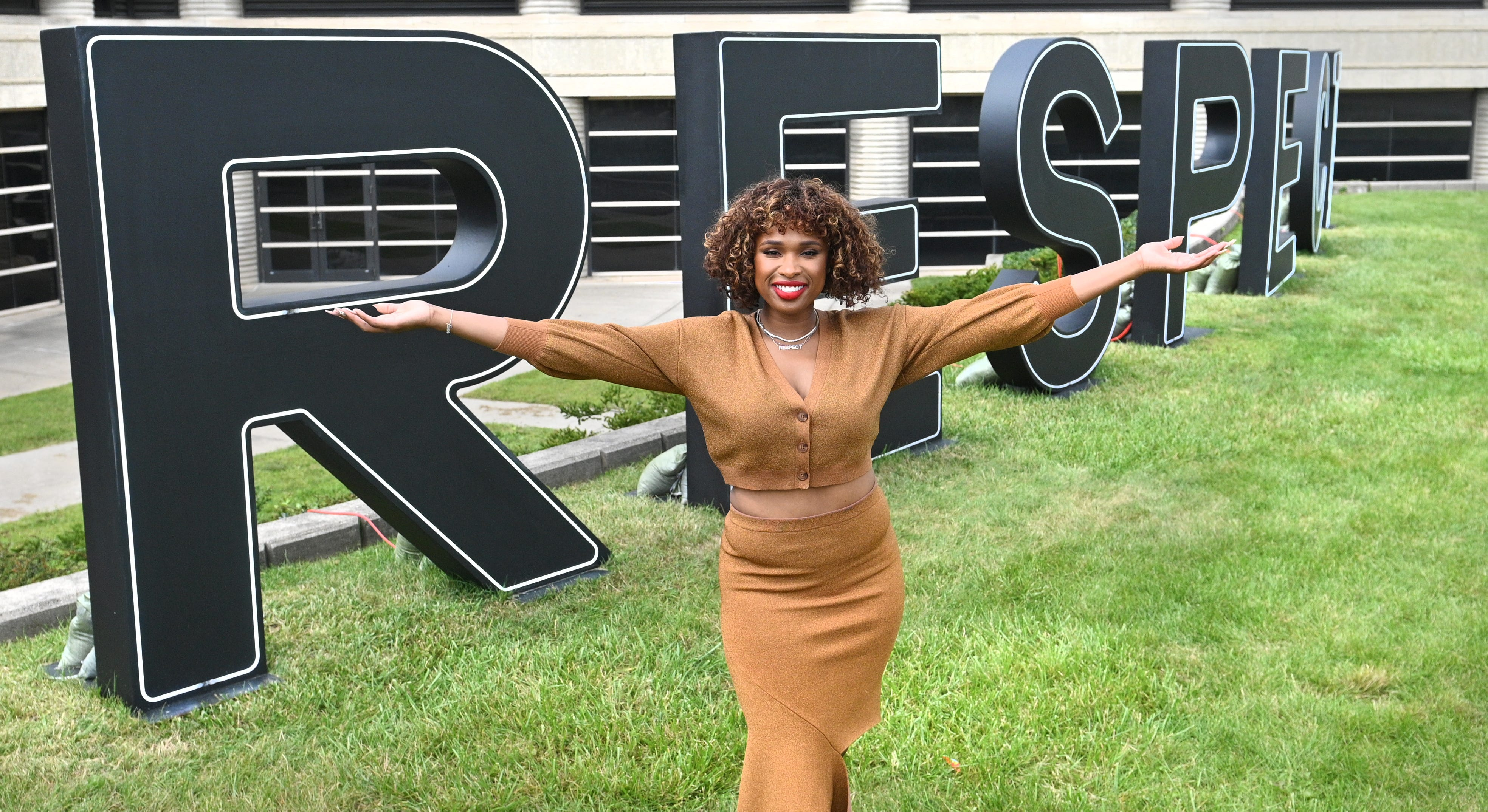 """Jennifer Hudson poses outside the Charles Wright Museum's light-up RESPECT letters in Detroit on Sunday during a conversation on the film """"Respect,"""" in which Hudson plays Aretha Franklin."""