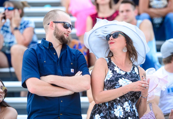 Horse racing fans fill the ExpoPark grandstands for Montana State Fair horse race meet on Saturday, July 31.