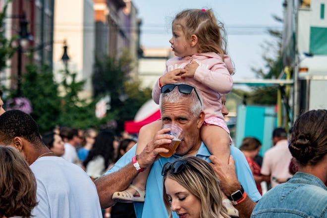 A Taste of Tippecanoe attendee drinks a cup of beer July 31, 2021, in Lafayette, Ind.