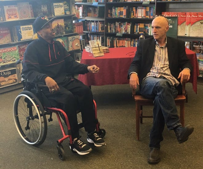 """Rus Bradburd, right, is pictured with Shawn Harrington. Harrington, a former New Mexico State University basketball player, is the subject of Bradburd's 2018 book, """"All the Dreams We've Dreamed."""""""