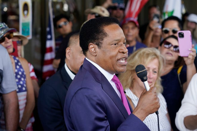 Conservative radio talk show host Larry Elder speaks to supporters during a campaign stop in Norwalk, Calif. on July. 13.