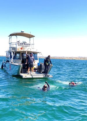 Divers search for Reyes Augustin Munoz-Rodriguez, who went missing in the Colorado River in Bullhead City on July 30.