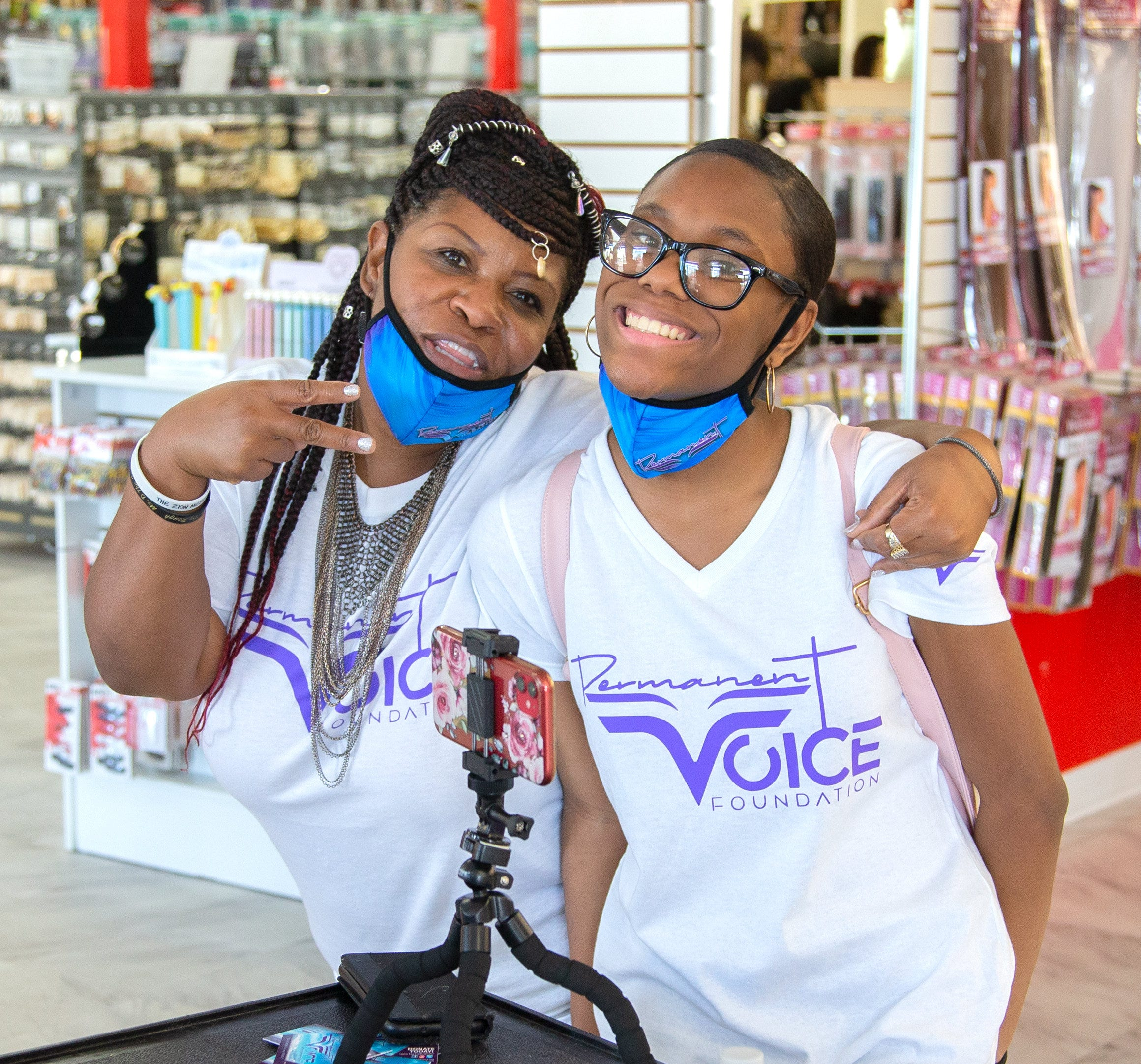 Dana Burns, founder and CEO of the Permanent Voice Foundation, poses for a picture with her daughter Tierra Neal at WABA Hair & Beauty Supply in Phoenix on July 30. Burns says Tierra was her inspiration for starting the Permanent Voice Foundation